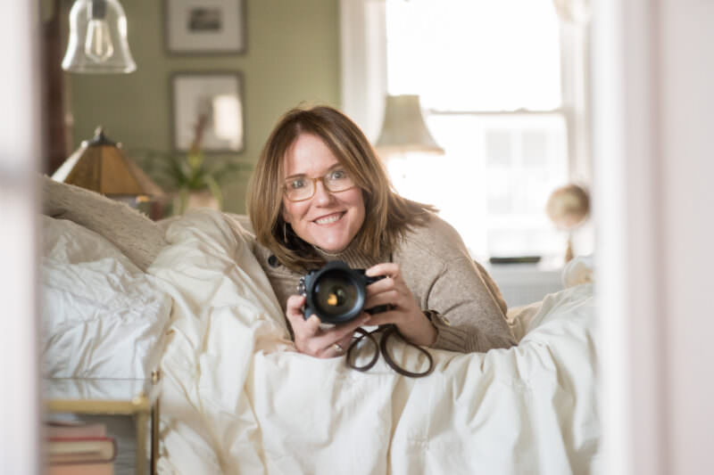 Jaye McLaughlin self portrait on bed with camera celebrating international women's day